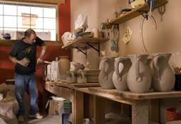 Kenneth Merril throwing a pot in his studio